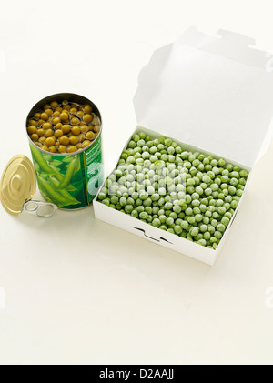 Canned peas with frozen peas - Stock Photo