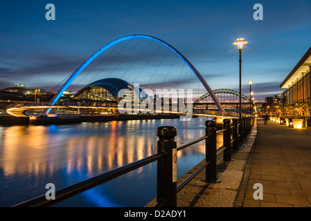 Lights reflected in River Tyne from Sage Gateshead and Millennium Bridge this view from Newcastle Quayside at night - Stock Photo
