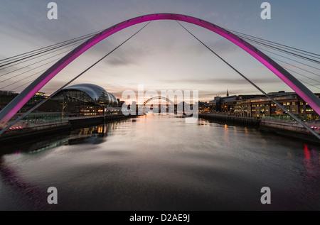 Tyneside at dusk,  view of river Tyne, Sage Gateshead  and Tyne Bridge from the Millennium Bridge between Newcastle - Stock Photo