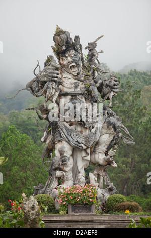 Indonesian hindu demon in the botanical gardens in Bali, Indonesia.