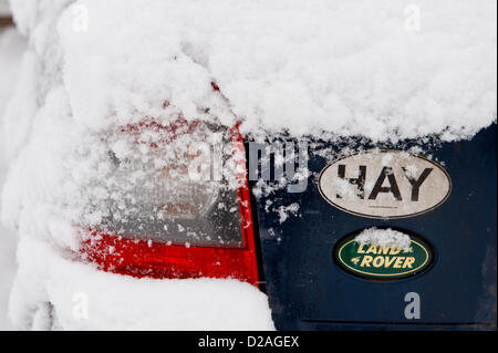 Land Rover 4x4 covered in snow with Hay sticker. Hay-on-Wye Powys Wales UK. 18th January 2013. Credit: Jeff Morgan/Alamy - Stock Photo
