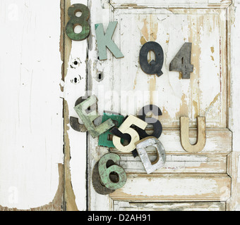Decorative wooden symbols on door - Stock Photo