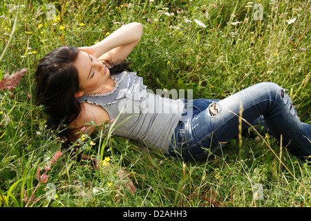 Woman laying in tall grass - Stock Photo