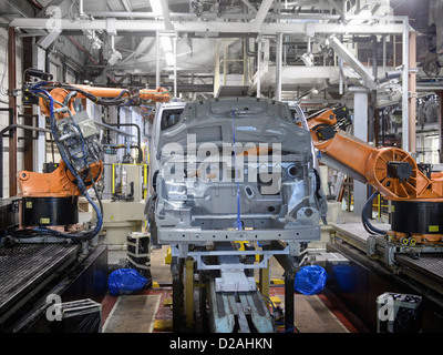 Robots at work in car factory - Stock Photo