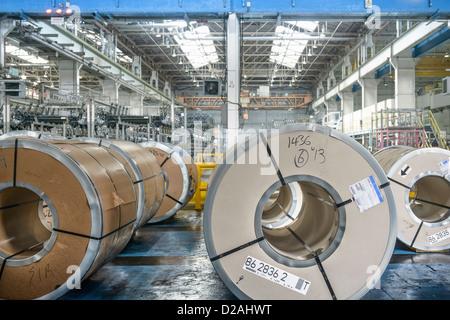 Rolls of steel in car factory - Stock Photo