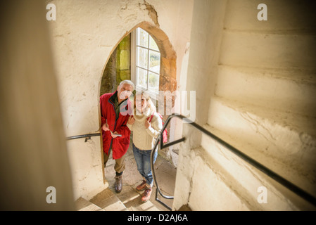 Couple exploring medieval castle - Stock Photo