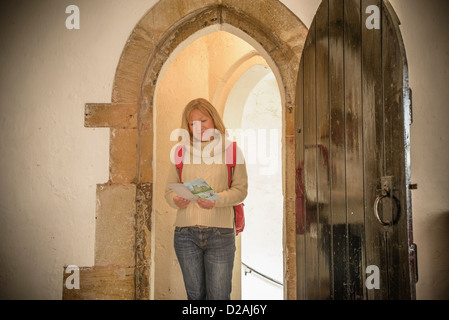 Woman exploring medieval castle - Stock Photo