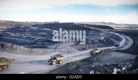 Trucks at surface coal mine site - Stock Photo