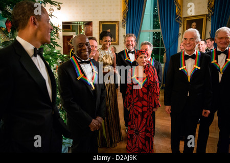 US President Barack Obama and First Lady Michele Obama talk with the 2012 Kennedy Center Honorees in the Blue Room - Stock Photo