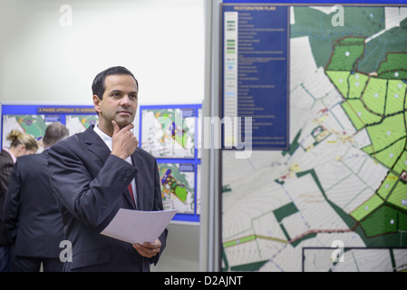 Man considering town hall proposal - Stock Photo