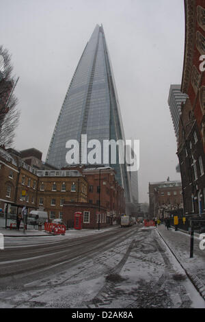 The Shard towers up into the falling snow  London, UK. 18th January 2013. - Stock Photo