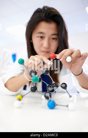 Student examining molecular model - Stock Photo