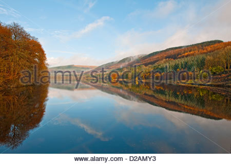 Rural hills reflected in still lake - Stock Photo