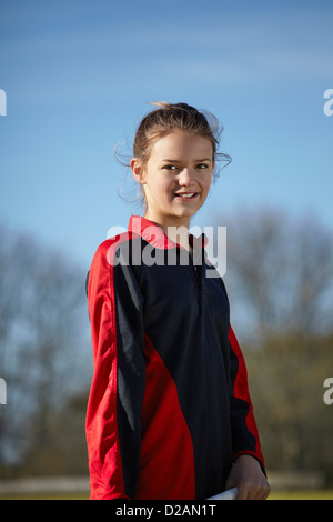 Girl standing on field - Stock Photo