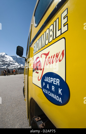 OLD YELLOW TOUR SNOWMOBILE AT VISITORS CENTER COLUMBIA ICEFIELD JASPER NATIONAL PARK ALBERTA CANADA - Stock Photo