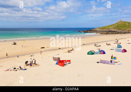 holidaymakers sunbathing and enjoying themselves on Porthmeor beach St Ives Cornwall England UK GB EU Europe - Stock Photo