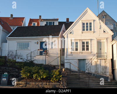 White wooden paneled houses in Old Stavanger Norway, a tourist attraction and a functioning  local community - Stock Photo