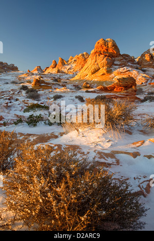 Snow on rock formations in Coyote Buttes in the Paria Canyon-Vermilion Cliffs Wilderness area along the Utah and - Stock Photo