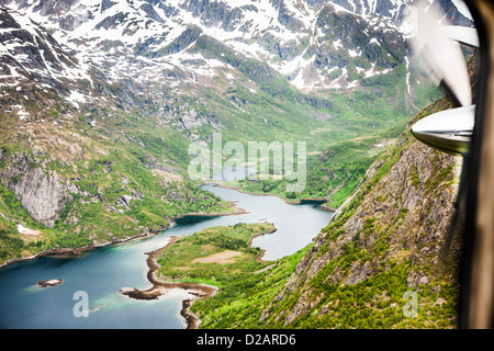 Glacial river in snowy mountain valley - Stock Photo