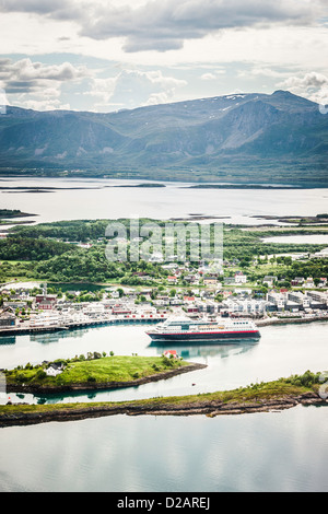 Aerial view of ship in village harbor - Stock Photo