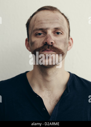 Close up of man with mustache - Stock Photo