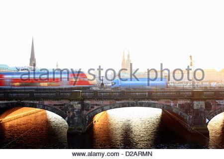 Time lapse view of bus on urban bridge - Stock Photo