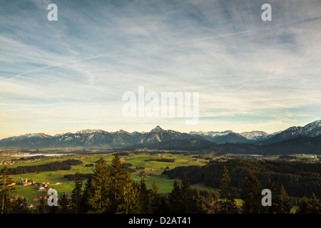 Clouds over rural landscape - Stock Photo