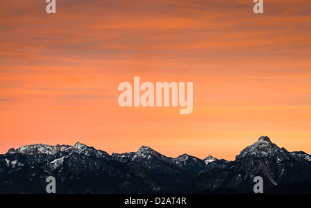 Colorful sky over snowy mountains - Stock Photo