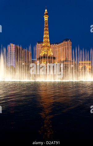 Eiffel Tower replica on Las Vegas Blvd. at nigh with Bellagio fountain show in foregroundt-Las Vegas, Nevada, USA. - Stock Photo