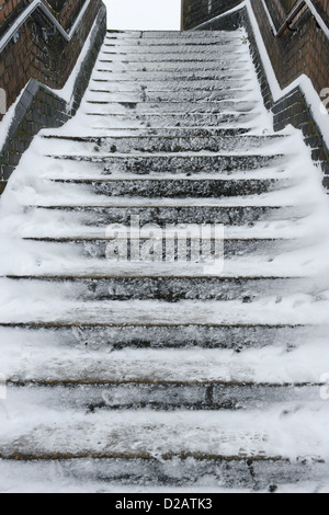 Slippery snow covered steps - Stock Photo