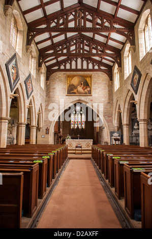 View down aisled nave (wooden pews, arcades) to chancel arch & altar -  interior of historic Church of Saint Mary, - Stock Photo