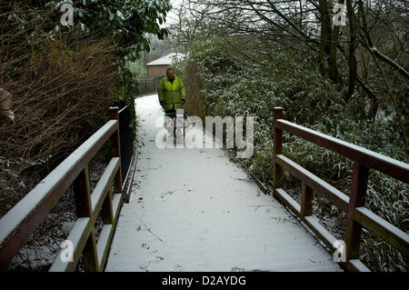 London, UK. Friday 18th January 2013. Gardener in Sydenham Wells Park readys to clear footpaths during London's - Stock Photo