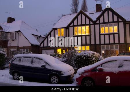 Surrey, UK. 18th Jan, 2013. UK, England, Surrey, house snow at dusk - Stock Photo