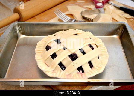 Fresh Blueberry Pie Ready for the Oven - Stock Photo