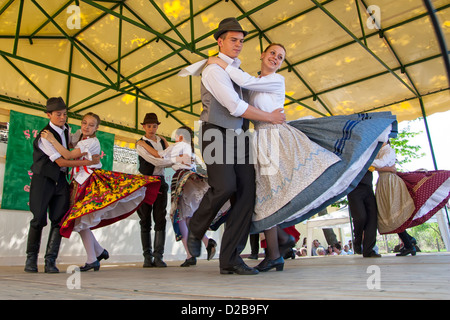Young people performing traditional Hungarian folk dance in traditional Dress - Stock Photo