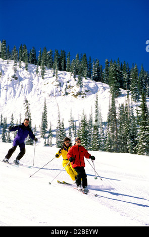 Colorado, Crested Butte: A Man And Two Women Skiing - Stock Photo