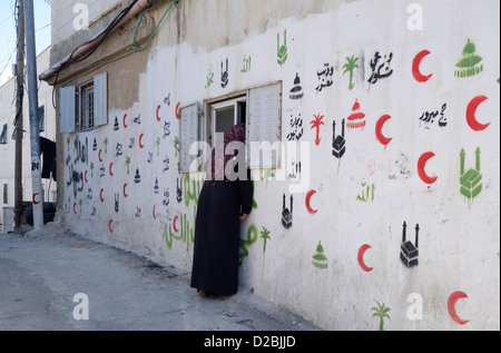 A house decorated with Hajj painting indicating Muslim inhabitants have visited Hajj landmarks during pilgrimage - Stock Photo
