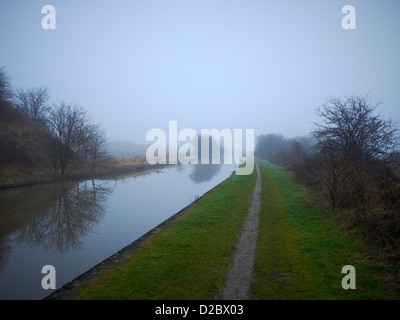 Trent and Mersey Canal on a misty winter morning in Sandbach Cheshire UK - Stock Photo