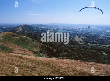 Paraglider above Malvern Hills looking south towards British Camp Worcestershire Midlands England UK - Stock Photo