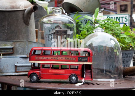 London, United Kingdom, red double-decker bus as a toy in a Troedelstand - Stock Photo
