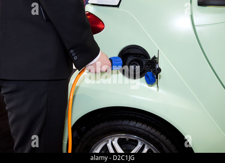essen germany an electric car is recharged at a charging station stock photo royalty free. Black Bedroom Furniture Sets. Home Design Ideas