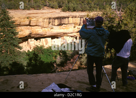 Colorado, Mesa Verde National Park. Photographers Photographing Spruce Tree House Overlook - Stock Photo