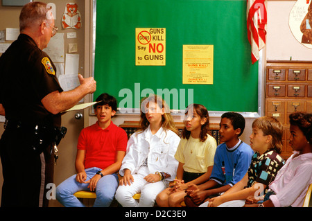 Policeman Talking To Group Of Students About Guns - Stock Photo