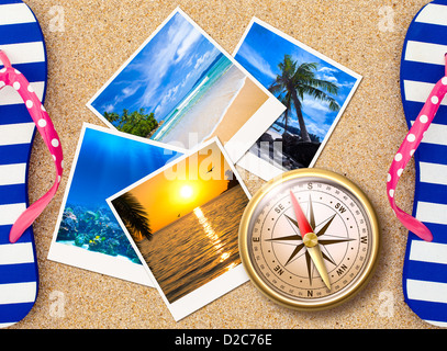 Traveling photos collage with compass on sand beach - Stock Photo