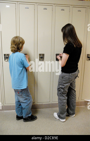 Middle School Students At Lockers. - Stock Photo
