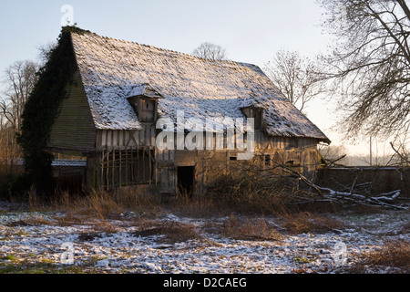 Old timbered dilapidated farmhouse in Normandy, France - Stock Photo