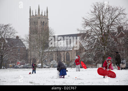 20 January 2013  13.16 PM - Snow falls on Clapham Common in Clapham, London, UK. Children playing in the snow with - Stock Photo