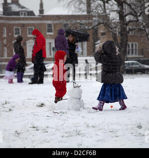 20 January 2013  13.16 PM - Snow falls on Clapham Common in Clapham, London, UK. Children playing in the snow. - Stock Photo
