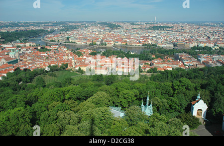 View Easy over Prague city from the top of the observation tower on Petrin Hill. Charles bridge can be seen in the - Stock Photo