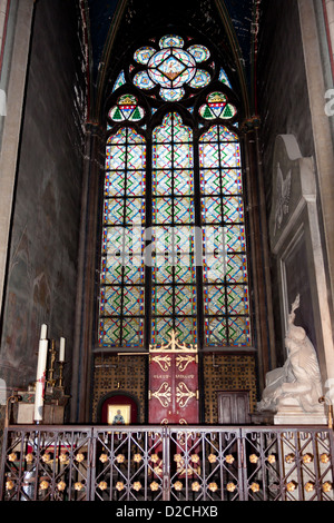 Gothic stained glass window in the Cathedral of Notre Dame de Paris - Stock Photo